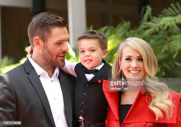 Carrie Underwood with her husband Mike Fisher and their son Isaiah Michael Fisher attend the ceremony honoring Carrie Underwood with a Star on The...