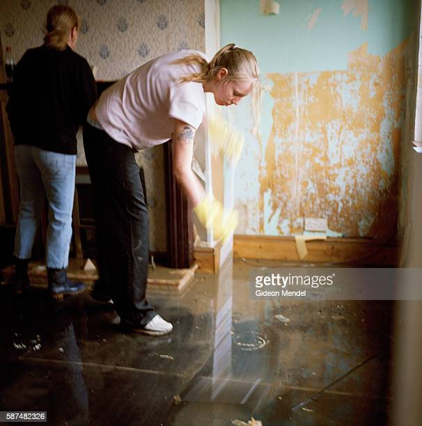 CarrieAnn Garner tries to sweep the last of the floodwater out Teresa Woodward's house in Toll Bar village Carrie Ann is a neighbour who was helping...
