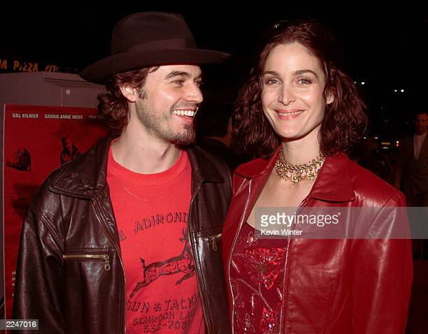 Carrie-Ann Moss and her husband Steven Roy at the World Premiere of 'Red Planet' at the Village Theater in Los Angeles, Ca. 11/6/00.