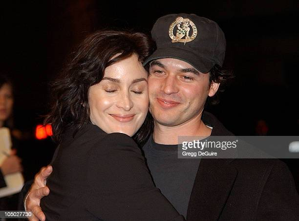CarrieAnne Moss and husband during Final Flight Of The Osiris World Premiere at Steven J Ross Theatre in Burbank California United States