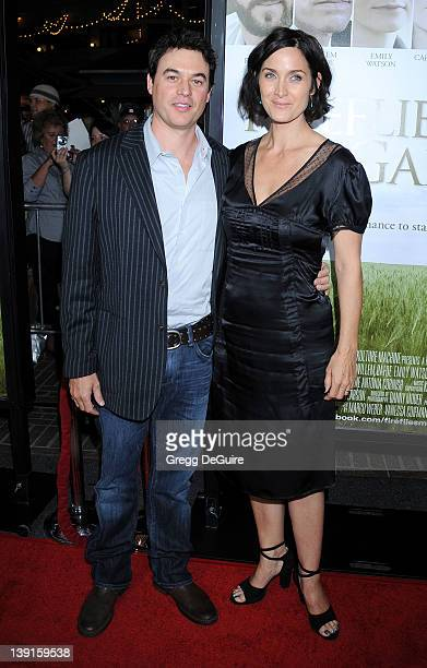 CarrieAnne Moss and husband Steven Roy arrive at the Los Angeles Premiere of Fireflies In The Garden at the Pacific Theatre at The Grove on October...