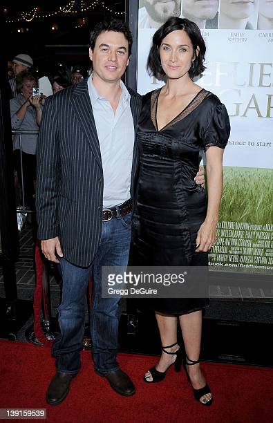 "Carrie-Anne Moss and husband Steven Roy arrive at the Los Angeles Premiere of ""Fireflies In The Garden"" at the Pacific Theatre at The Grove on..."