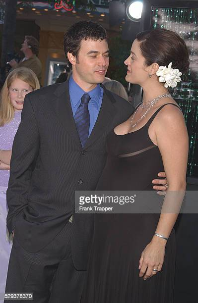 "Carrie-Anne Moss and husband Steven Roy arriving at the premiere of ""The Matrix Reloaded."""