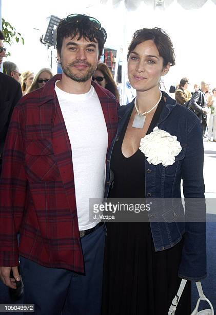 CarrieAnne Moss and husband Steven Roy during The 18th Annual IFP Independent Spirit Awards Arrivals at Santa Monica Beach in Santa Monica California...