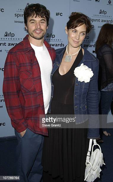 Carrie-Anne Moss and husband Steven Roy during The 18th Annual IFP Independent Spirit Awards - Arrivals at Santa Monica Beach in Santa Monica,...