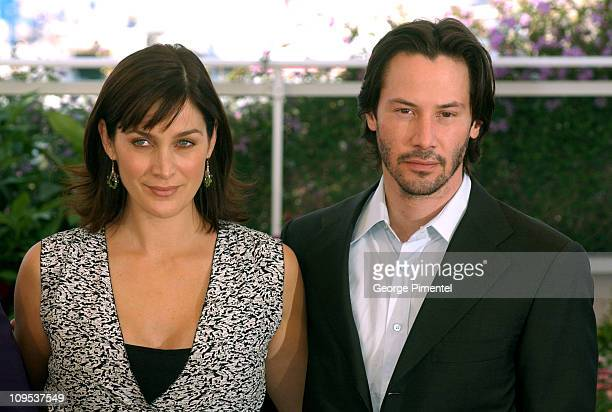 CarrieAnne Moss and Keanu Reeves during 2003 Cannes Film Festival Matrix Reloaded Photo Call at Palais des Festivals in Cannes France