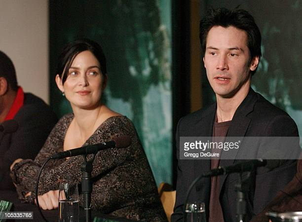 CarrieAnne Moss and Keanu Reeves during Los Angeles Press Conference with The Cast of The Matrix Revolutions at Disney Concert Hall in Los Angeles...