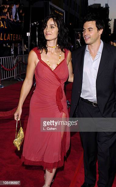 "Carrie-Anne Moss and Steven Roy during ""Collateral"" Los Angeles Premiere - Red Carpet at Orpheum Theatre in Los Angeles, California, United States."