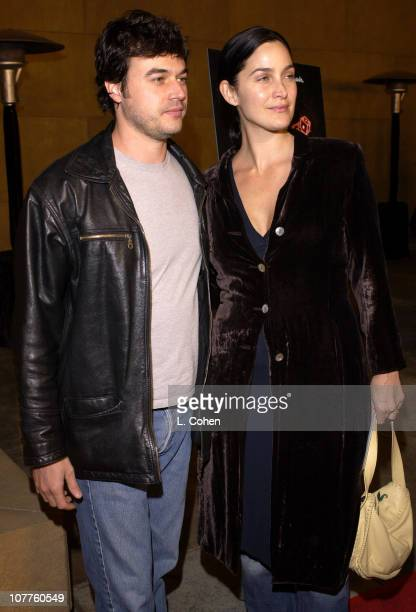 CarrieAnne Moss and Steven Roy during The Cooler Los Angeles Premiere Red Carpet at The Egyptian Theater in Hollywood California United States