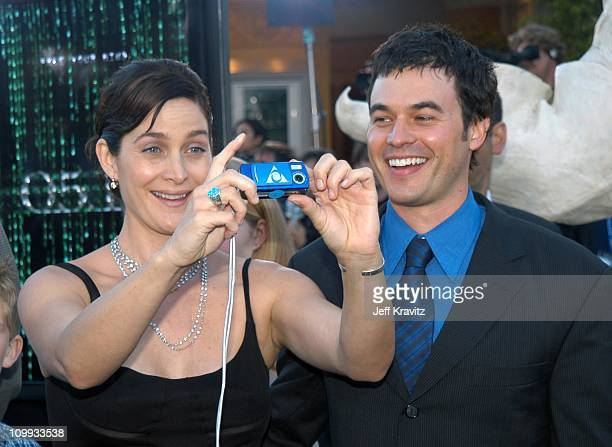 Carrie-Anne Moss and Steven Roy during The Matrix Reloaded Premiere at Mann Village Theater in Westwood, California, United States.
