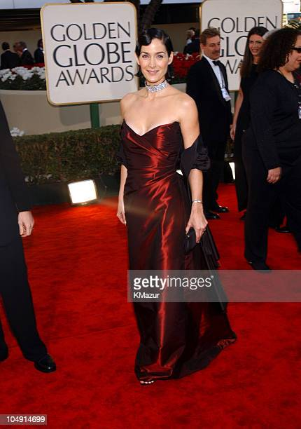 CarrieAnne Moss arrives at the Golden Globe Awards at the Beverly Hilton January 20 2002 in Beverly Hills California