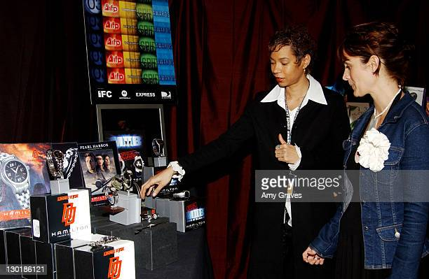 Carrie-Anne Moss looking at Hamilton Watch display