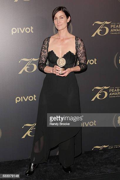 CarrieAnne Moss poses in the press room with the Peabody for Marvel's Jessica Jones after the 75th Annual Peabody Awards Ceremony at Cipriani Wall...