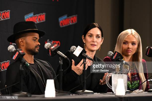 "Carrie-Anne Moss speaks during the ""Tell Me a Story"" panel and special screening with Eka Darville and Natalie Alyn Lind during New York Comic Con at..."