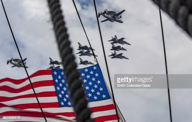 Carrier Air Wing airplanes and the French Carrier Air Wing flying over the aircraft carrier USS George HW Bush Chesapeake 2018 Atlantic Ocean May 15...