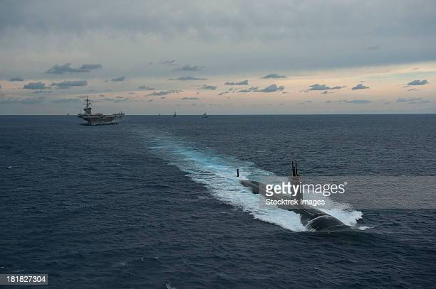 carrier strike group formation of ships in the bay of bengal. - indian ocean stock pictures, royalty-free photos & images