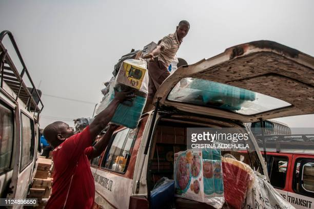 TOPSHOT Carriers load items at the Ariaria International Market in Aba a city in one of the proBiafran separatist regions of Nigeria to sell them in...