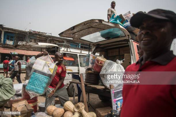 Carriers load items into a van at the Ariaria International Market to sell in other markets around the city in Aba a city in one of the proBiafran...