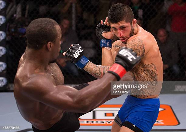 Carrington Banks kicks Sabah Homasi in their bout during the filming of The Ultimate Fighter American Top Team vs Blackzilians on February 6 2015 in...