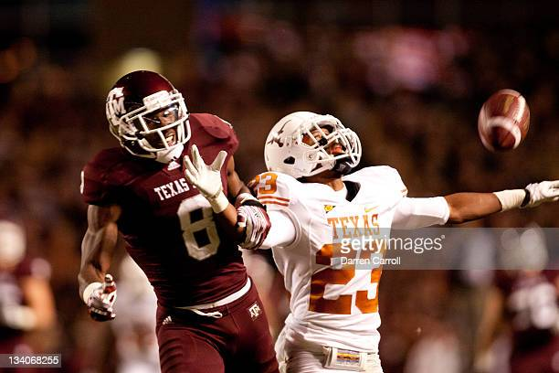 Carrington Byndom of the Texas Longhorns breaks up a pass intended for Jeff Fuller of the Texas AM Aggies in the first half of a game at Kyle Field...
