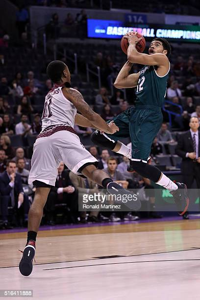 Carrington Love of the Green Bay Phoenix shoots the ball in the first half against Anthony Collins of the Texas AM Aggies during the first round of...