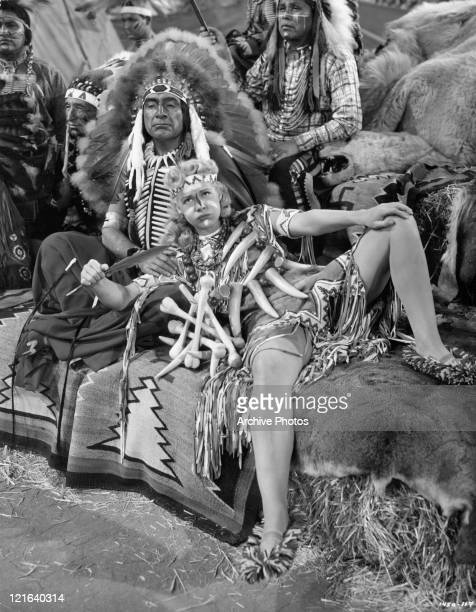 J Carrol Naish adopts Betty Hutton as a princess of his Sioux tribe in a scene from the film 'Annie Get Your Gun' 1950