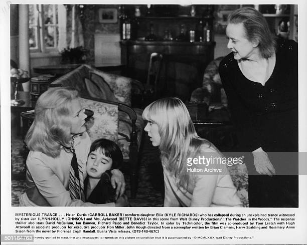Carroll Baker holds Kyle Richards as LynnHolly Johnson and Bette Davis look scared in a scene for the Walt Disney movie The Watcher in the Woods...