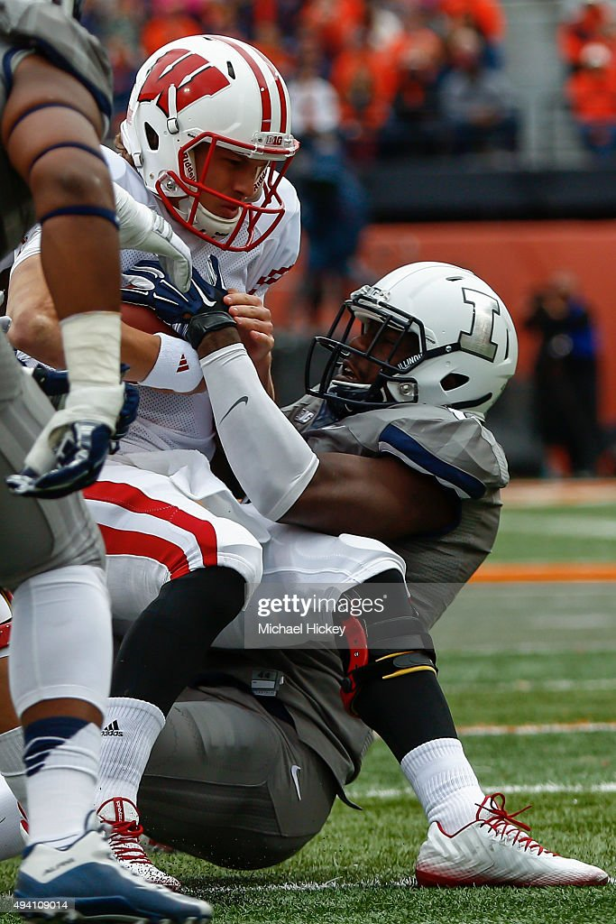 Carroll Phillips #6 of the Illinois Fighting Illini sacks Joel Stave #2 of the Wisconsin Badgers who would eventually leave the game with an injury at Memorial Stadium on October 24, 2015 in Champaign, Illinois. Wisconsin defeated Illinois 24-13.