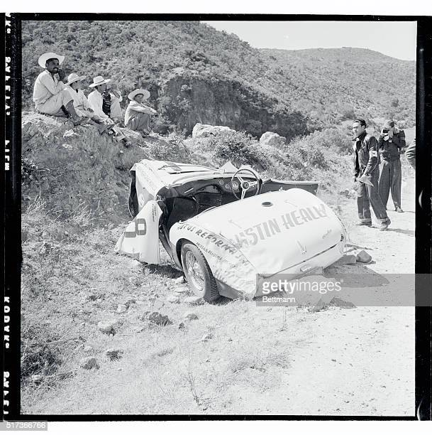 Carroll Shelby of Dallas, Texas, talks to officials while waiting for an ambulance after he overturned in his Austin Healy. It was the second day of...