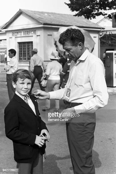 Carroll Shelby, Paul-Henri Cahier, Grand Prix of Italy, Autodromo Nazionale Monza, 06 September 1964. Paul-Henri Cahier getting a Cobra pin from...