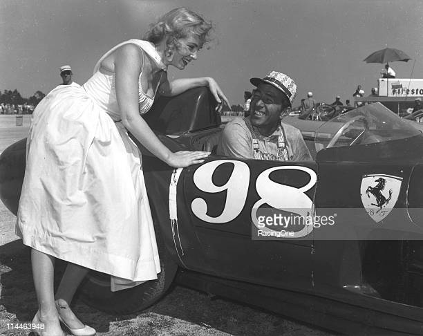 Carroll Shelby poses before a sports car race at the New Smyrna Beach Airport, which he won.