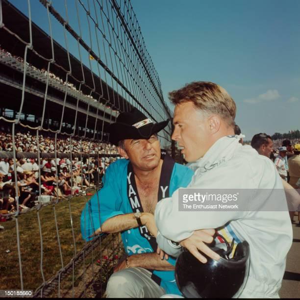 Carroll Shelby talks with Dan Gurney on the grid