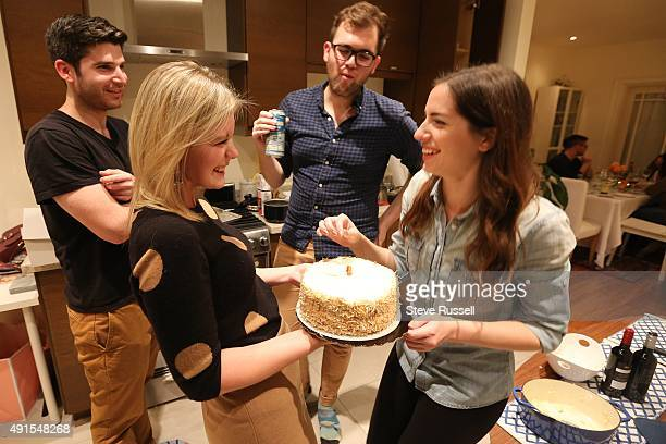 TORONTO ON OCTOBER 2 Carrot cake brought by one of the guests is served up for desert Toronto Star reporter Lauren Pelley hosts a Friendsgiving...