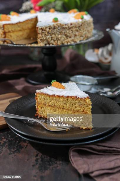 carrot cake in rustic barn kitchen with spring tulips for easter brunch - easter sunday stock pictures, royalty-free photos & images