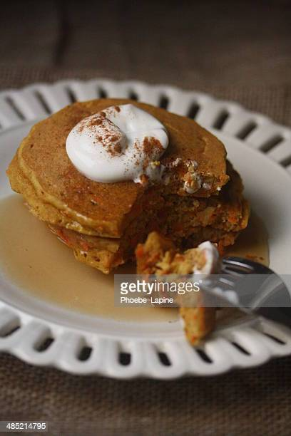 Carrot cake pancakes with yogurt, warm maple syrup and cinnamon