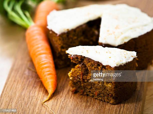 Carrot cake with a carrot on the side