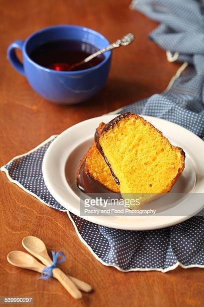 carrot cake with chocolate glaze - carrot cake stock pictures, royalty-free photos & images
