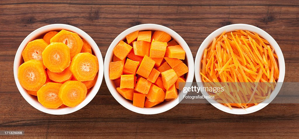 Carrot in bowls : Stock Photo