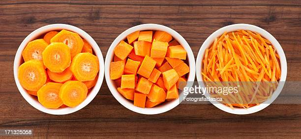 carrot in bowls - carrot stock pictures, royalty-free photos & images