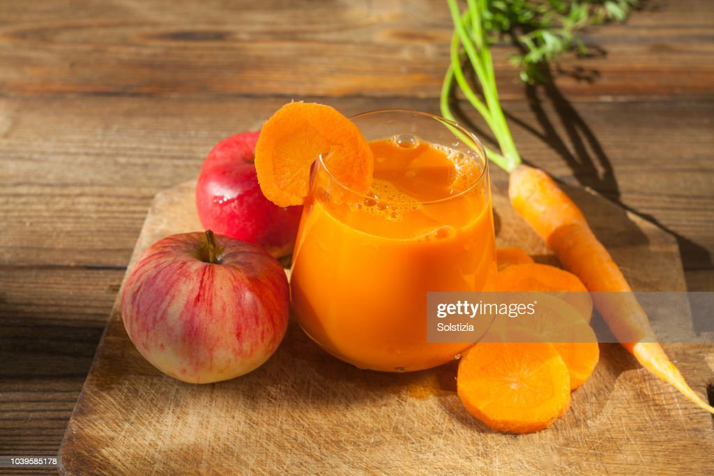 Carrot juice in glass on  table : Stock Photo