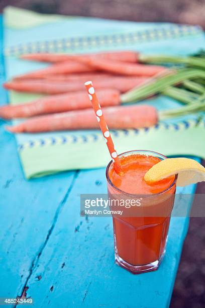 Carrot juice on picnic table