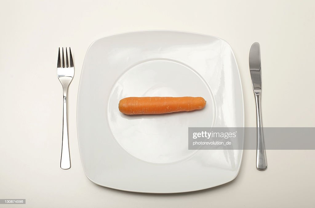 Carrot on a white plate : Stock Photo