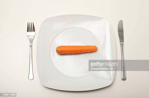 Carrot on a white plate