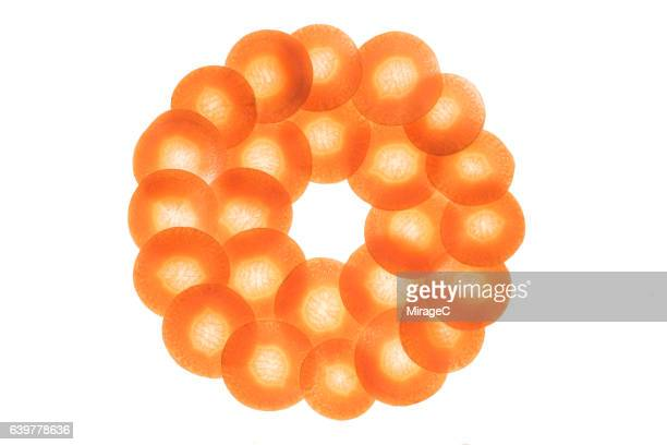carrot slices circle loop on white background - lightbox stock photos and pictures