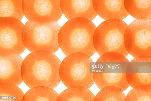 carrot slices on white background - lightbox stock pictures, royalty-free photos & images