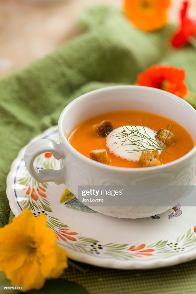 Carrot soup with crème fraîche : Stock Photo