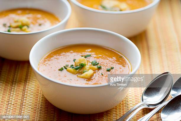 Carrot soup with croutons and chives
