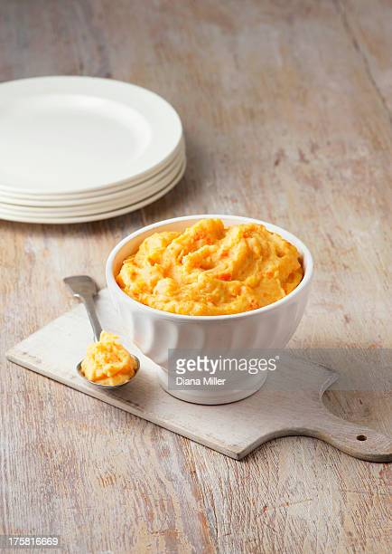 carrot, swede and potato mash in rustic white bowl with large metal spoon - rutabaga stock pictures, royalty-free photos & images