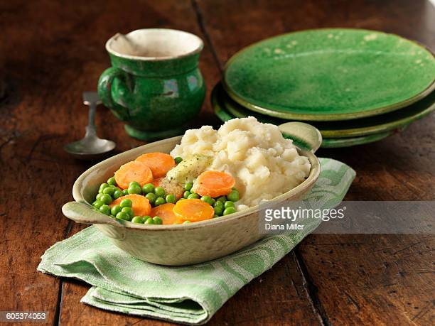 Carrots and peas with mashed potato in oval dish