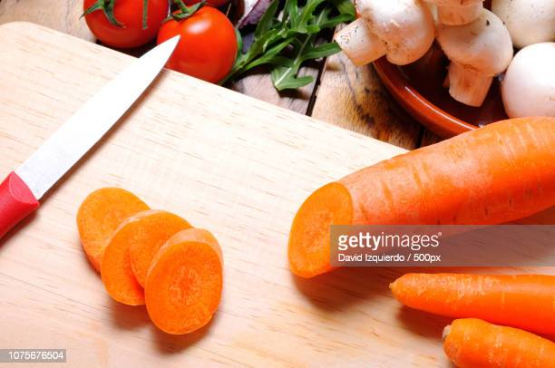 Carrots on a cutting board in the kitchen table top view